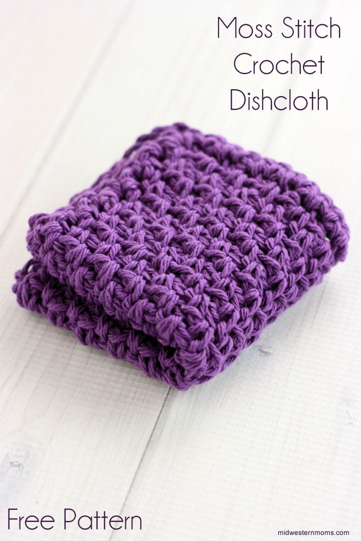 Purple dishcloth made with the Moss Stitch. The crocheted dishcloth is folded in quarters and sitting on a white background.