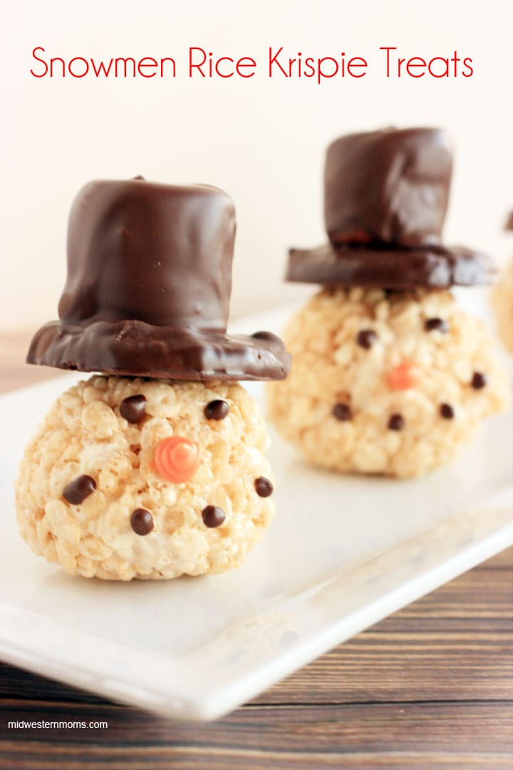 Snowmen Rice Krispie Treats. Rice Krispie Treats made into balls for snowmen heads. Top hats are made from shortbread cookies and large marshmallows covered in dark chocolate.