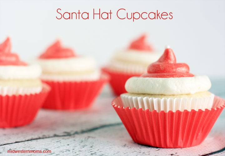 This Santa Hat Cupcakes Recipe is made with a doctored up cake mix, buttercream icing, and white sugar pearls. This doctored up cake mix recipe is the BEST!