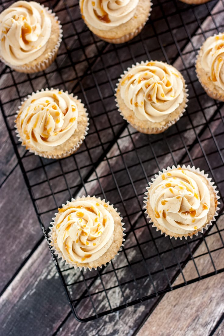 Delicious Caramel Apple Cupcakes. These apple cupcakes are topped with Caramel Frosting and drizzled with caramel. YUM!