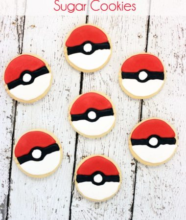 Pokemon Sugar Cookies! Using a Pokeball cookie cutter and royal icing, these sugar cookies were transformed into Poke Balls! Good idea for Pokemon Themed parties!