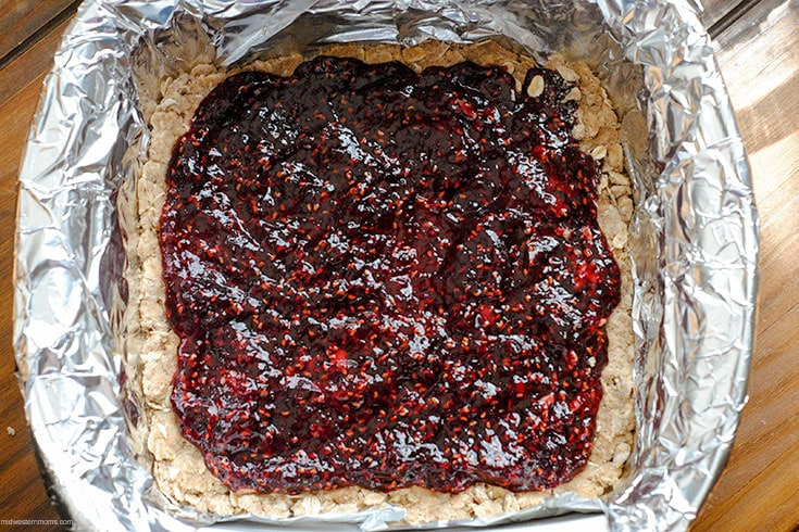 Spread the preserves over the crust