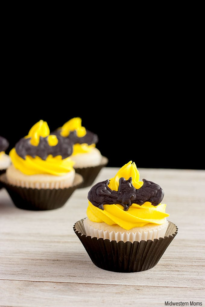 These Batman cupcakes look like the bat signal. White cupcakes topped with homemade yellow buttercream frosting and a candy bat shape.