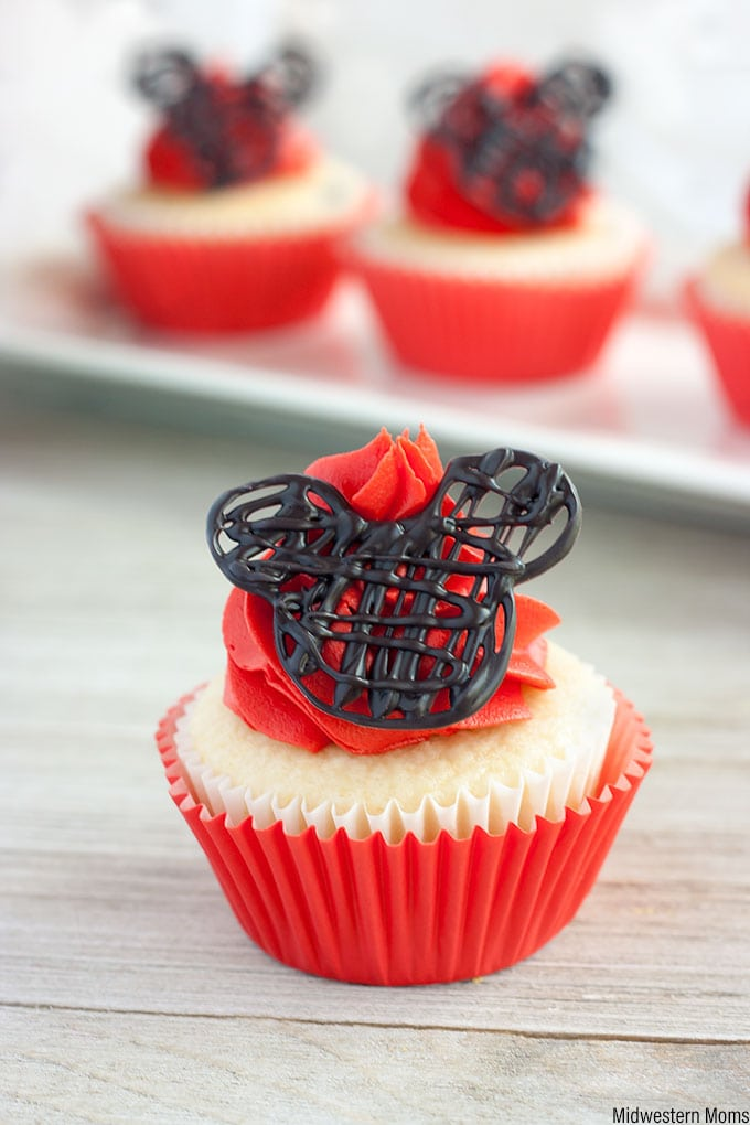 Mickey Mouse cupcakes are white cupcakes topped with homemade red buttercream frosting and topper with a candy Mickey shape.