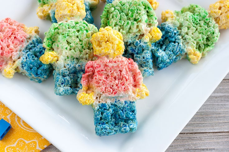 Close up of Lego figure rice krispie treats on a white plate.