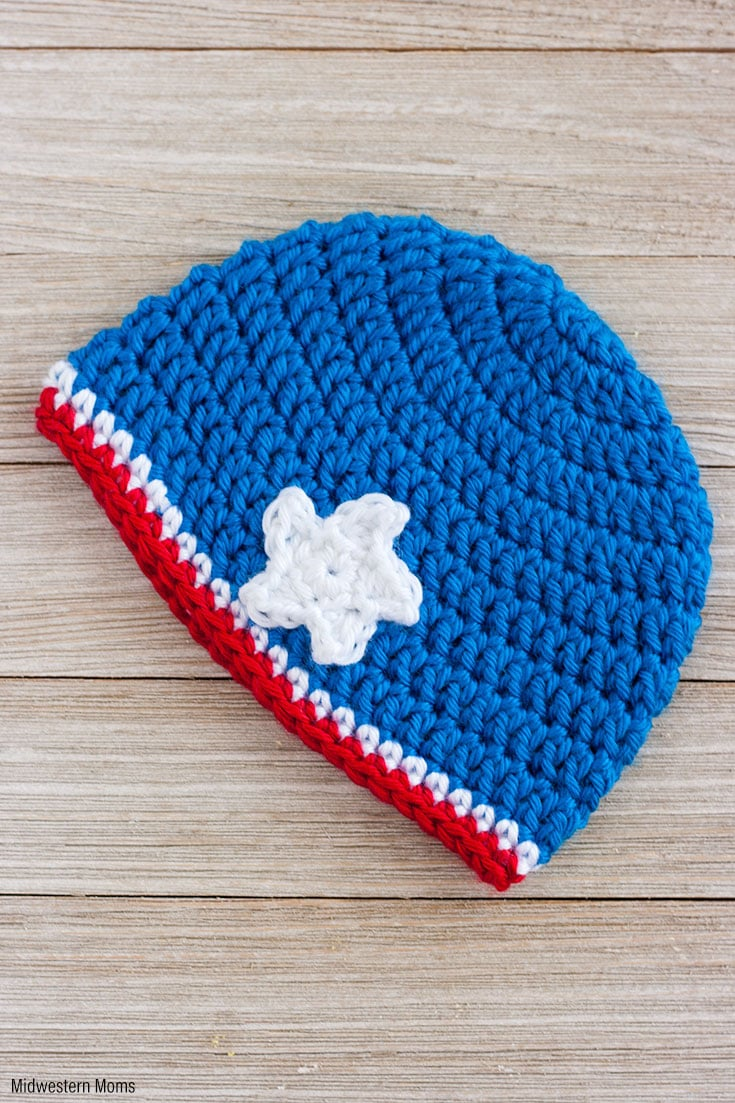A Simple Patriotic Crochet Baby Hat Pattern for a Girl! This red, white, and blue hat is finished off with a little star is perfect for showing patriotism!