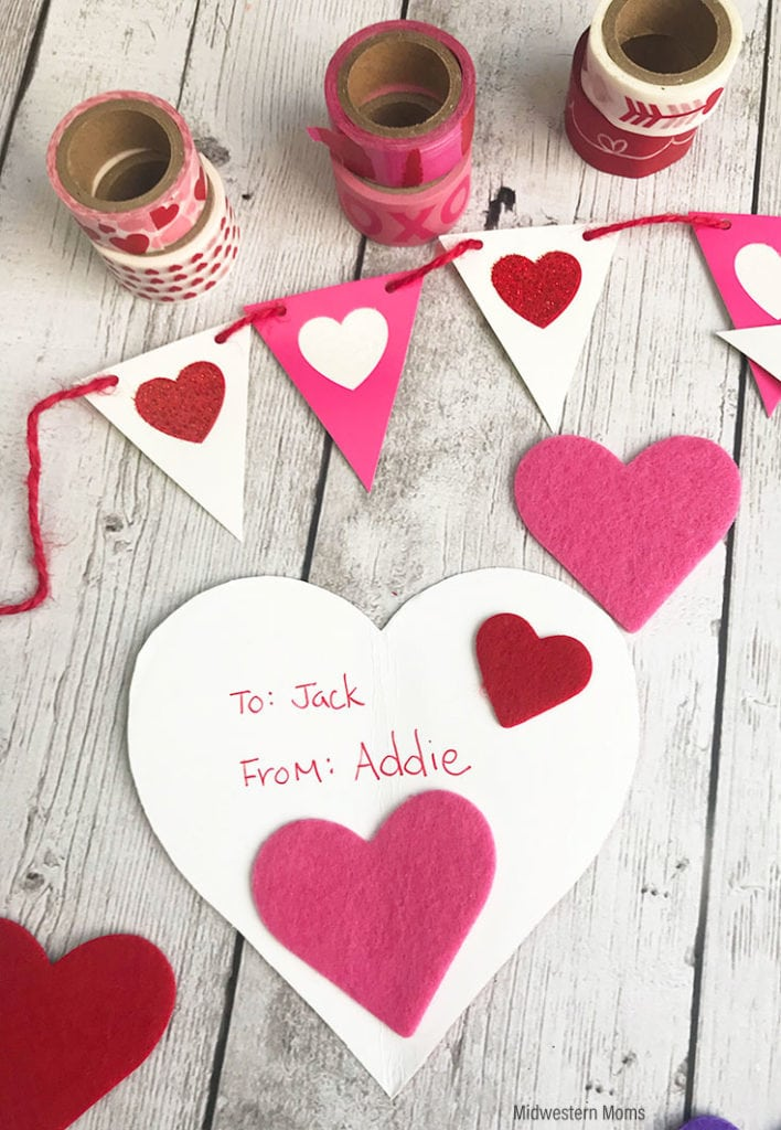 Write The To and From information on the back of the valentine.