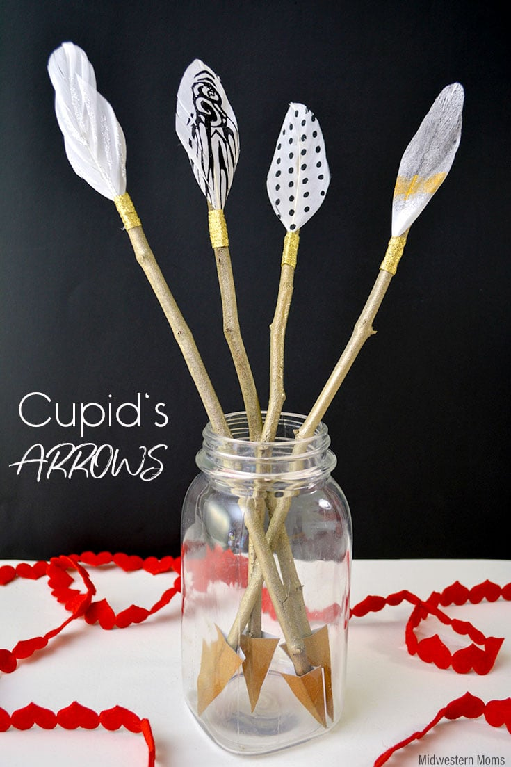 Homemade cupid's arrows in a mason jar.