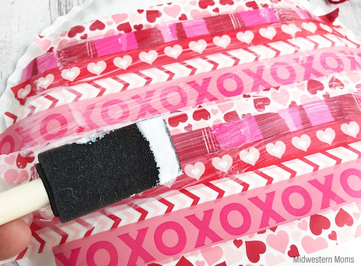 Apply a generous amount of mod podge over the washi tape