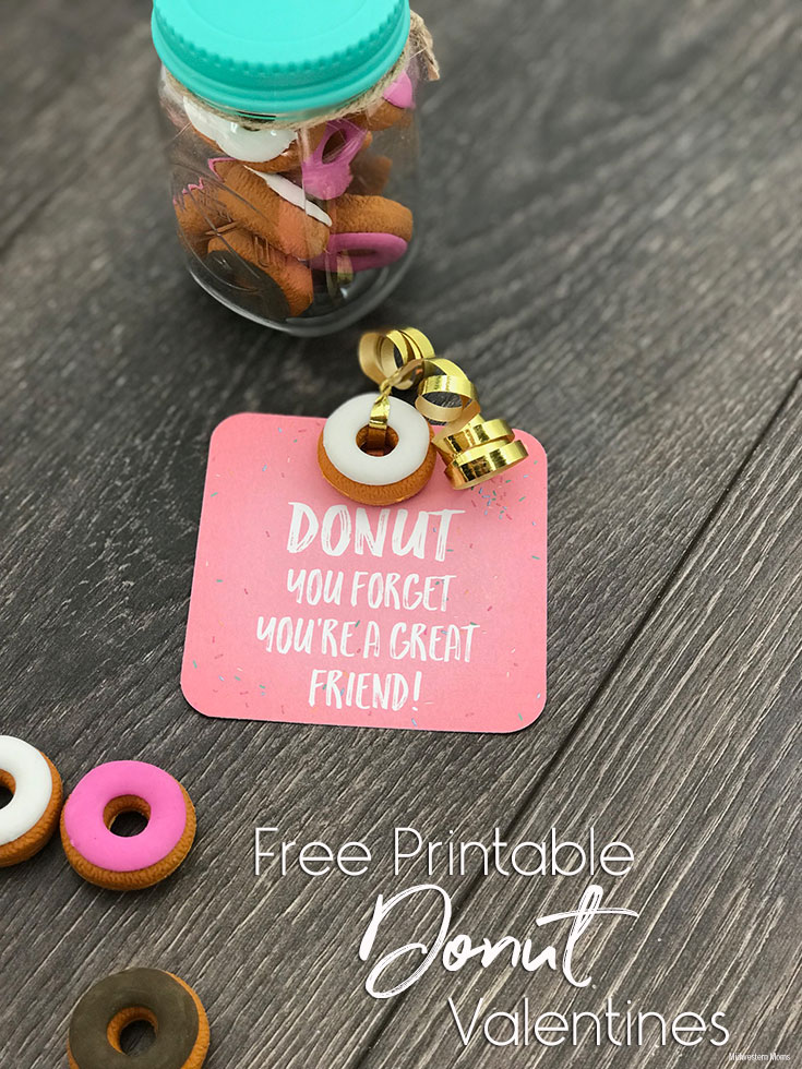 Printed Donut Valentine with Donut eraser attached with gold ribbon. Sitting next to a jar of donut erasers