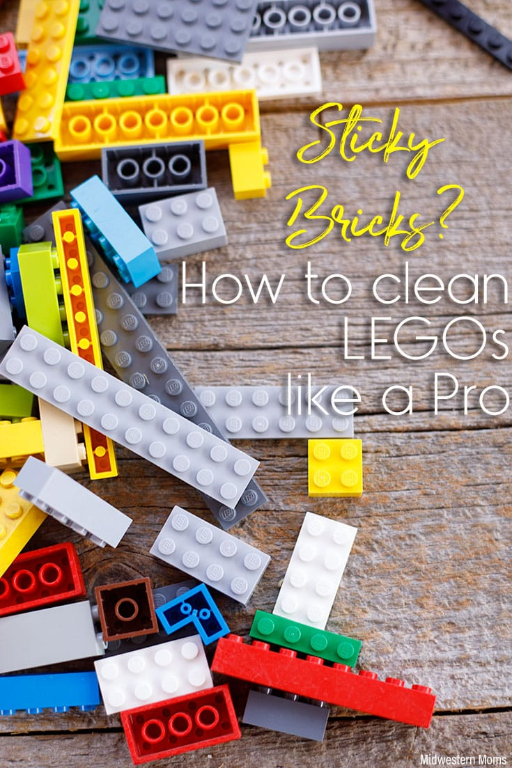 "Legos laid on a wooden background. The words ""Sticky Bricks? How to clean LEGOs like a Pro"" overlaid on the photo."