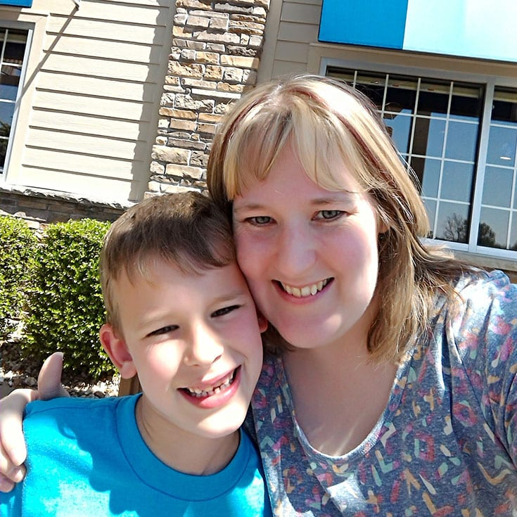 A photo of my son and myself sitting outside Culver's waiting on our food.