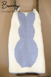 Bunny crochet blanket hanging on a blanket ladder.