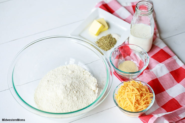 Ingredients for the Garlic Cheddar Biscuits sitting on a white table.